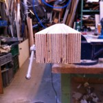 The neck after planing the fingerboard side, where I will glue the cutting template printout